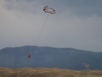 Helicopter Picking Up Water to Douse Fires