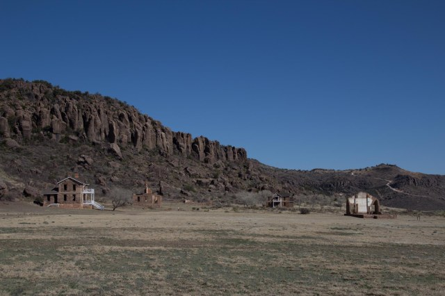 View of hills and old buildings at Fort Davis National Historic Site