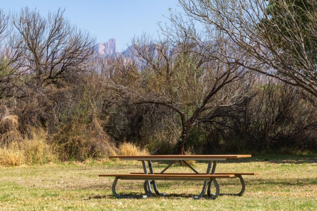 Picnic table with mountains in background