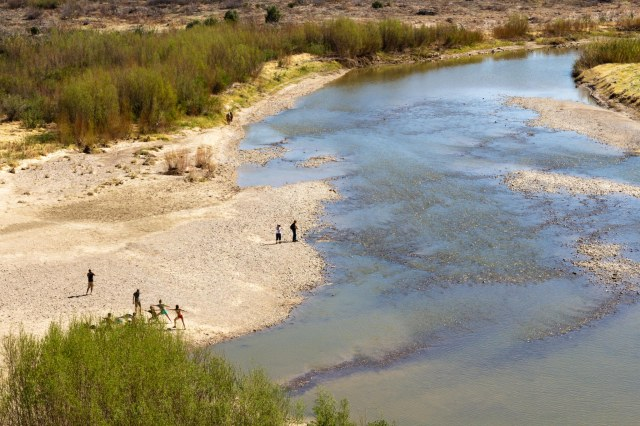 Birdseye view of Rio Grande River and people on the shore