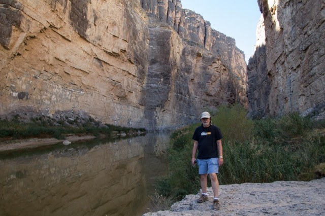 Man standing along the Rio Grande River in the Santa Elena Canyon