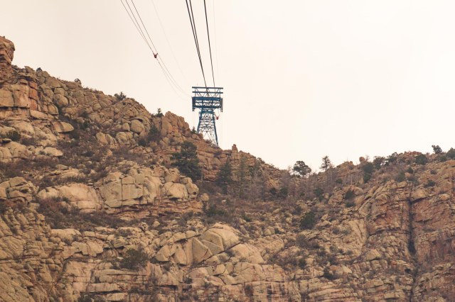 Tram cable tower atop a rocky cliff