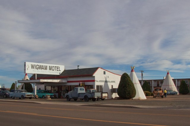 Wigwam Motel with tepees and antique cars