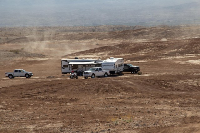 Trucks and RVs in sandy area