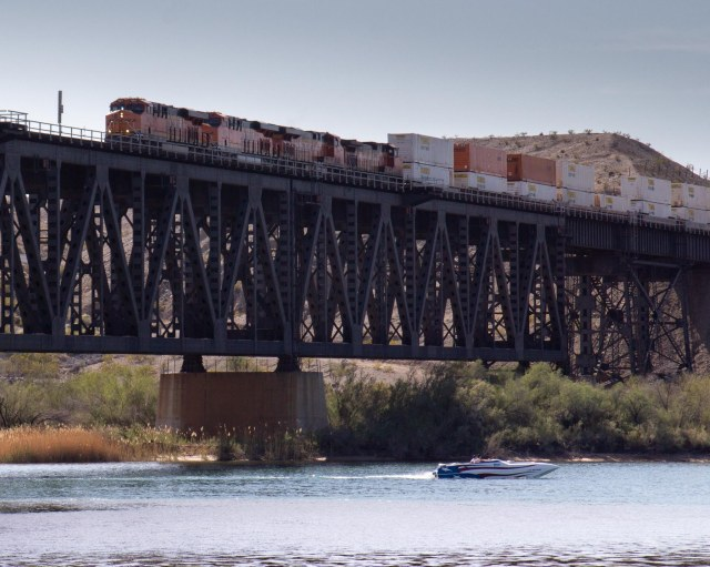 Freight train, trestles, river and boat