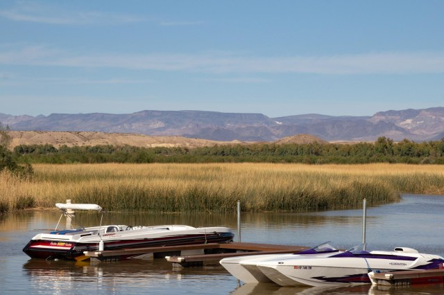 Marina, boats, reeds and mountains