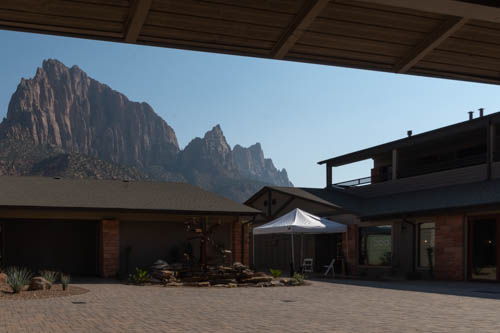 View of craggy cliffs behind a courtyard