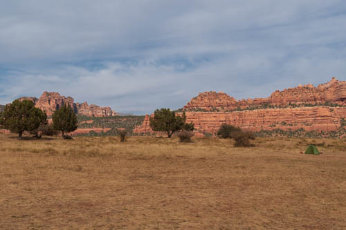 Red mountain cliffs and trees