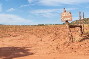 Red sandy field with camping sign