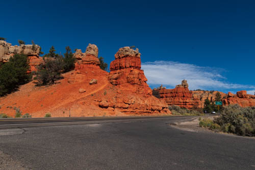 Red rock formations next to a road