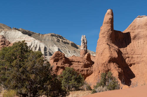 Kodachrome spires and chimneys and rock formations against blue sky