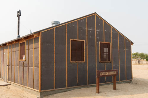 Wood and tar paper building used as women's latrine