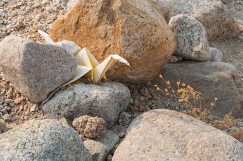 Origami wedged among rocks