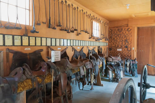 Saddles, brands, horseshoes on display