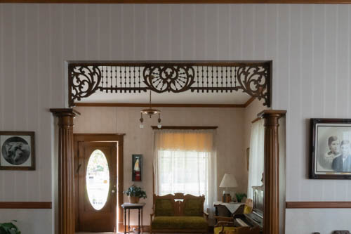 Inside an early 1900s home with wood accents and papered walls