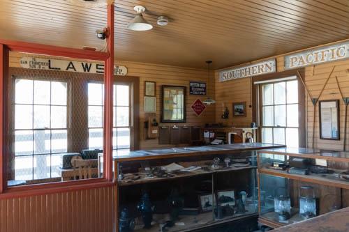 Displays of train memorabilia inside train depot