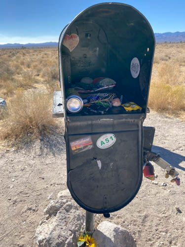 Snacks, rocks, and random stuff inside a black mailbox