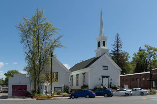 White steeple church and rectory